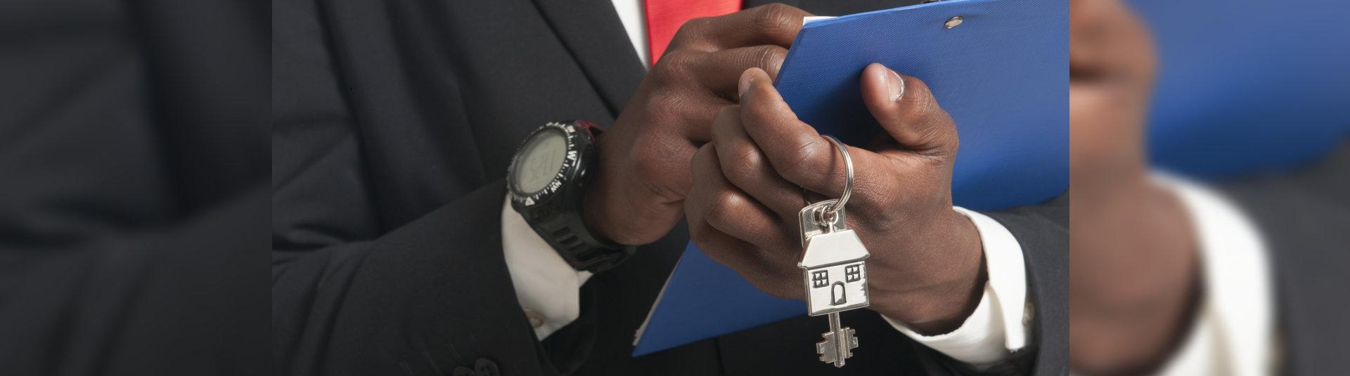 hand holding a house keychain